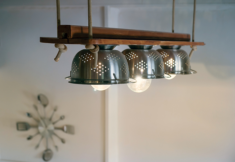 Kitchen makeover hacks: Kitchen lighting feature made from colanders
