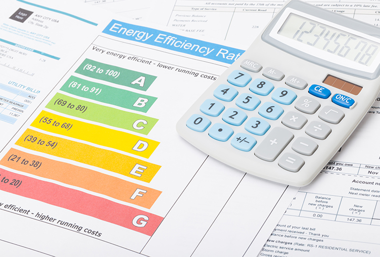 Energy efficiency rating with calculator and documents on table