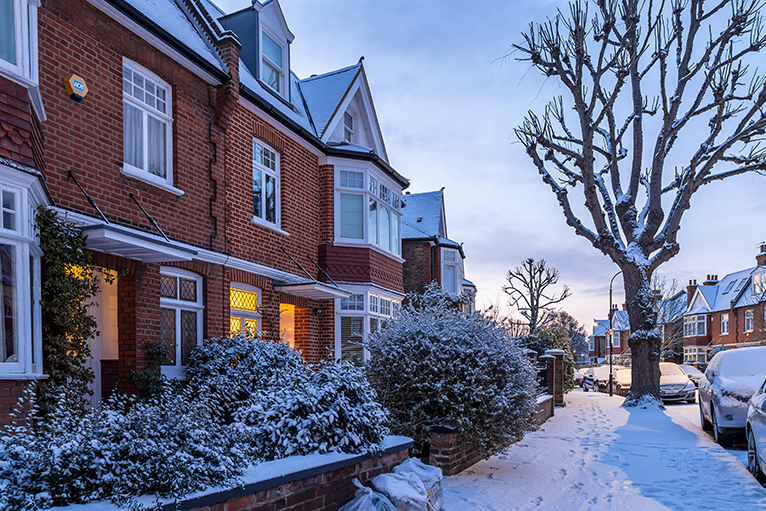 Snow covered terraced houses in London, UK