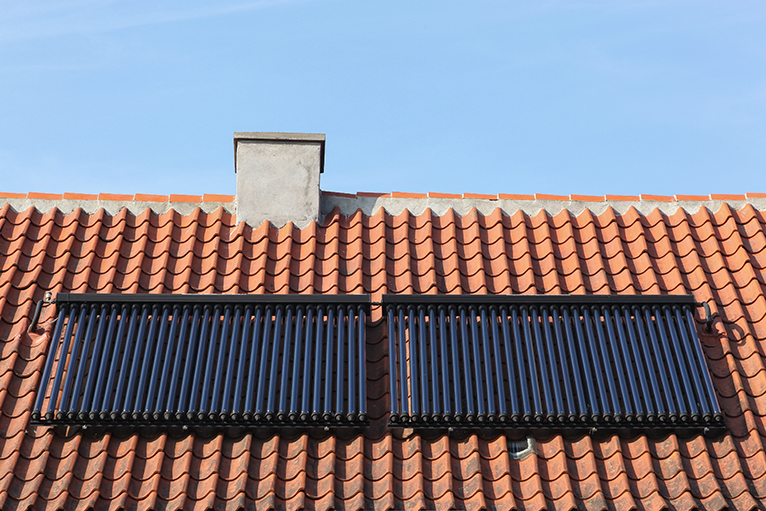 Energy efficiency home grants: Solar thermal panels on roof of house