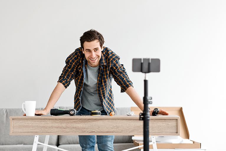 Builder filming social media videos on mobile phone