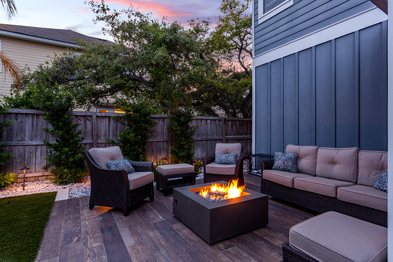 Gardening and landscaping trends: Firepit on patio in back garden