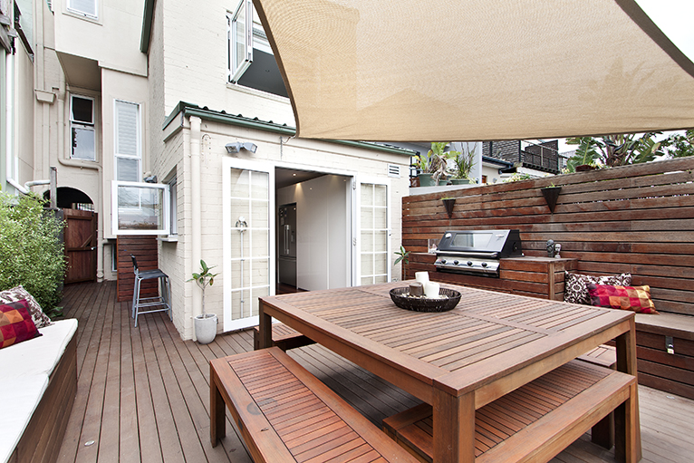 Wooden patio area with built-in BBQ