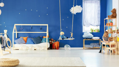 Childrens bedroom with swing and wooden furniture