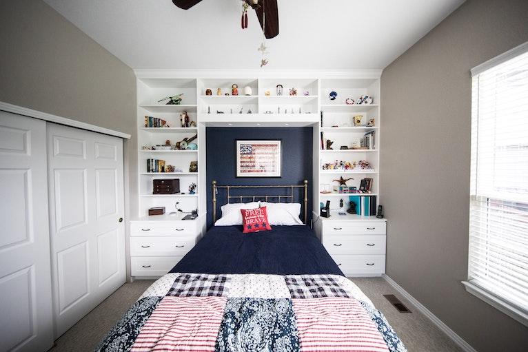 Bedroom with built-in storage around bed