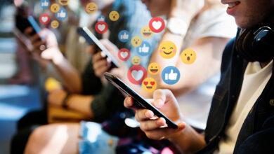 People using emojis on mobile phones