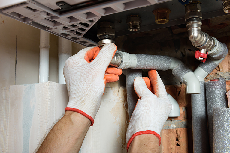 Gas and heating engineer insulating pipes