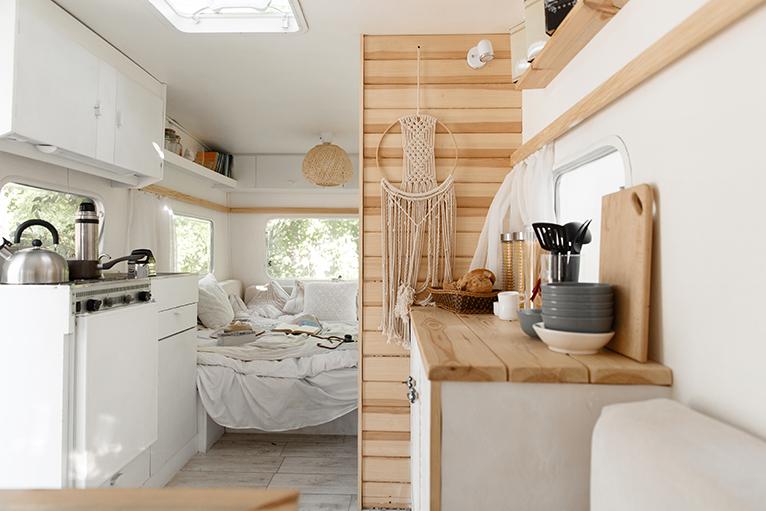 Kitchen and bedroom area in camper van