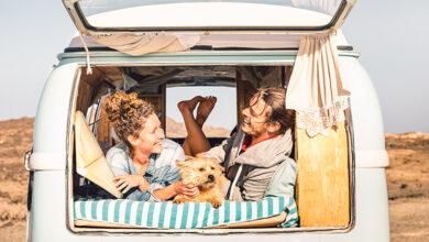 People and dog enjoying camper van
