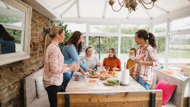 Friends preparing lunch in conservatory