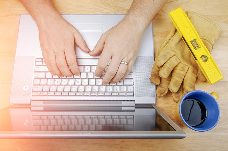Tradesperson using laptop