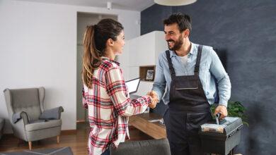 Happy customer shaking hands with handyman