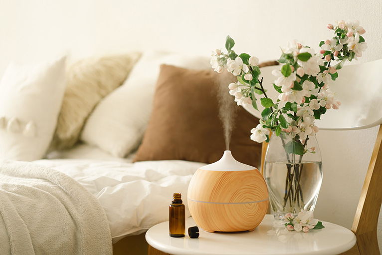 Wellbeing home design: Aroma oil diffuser on bedside table