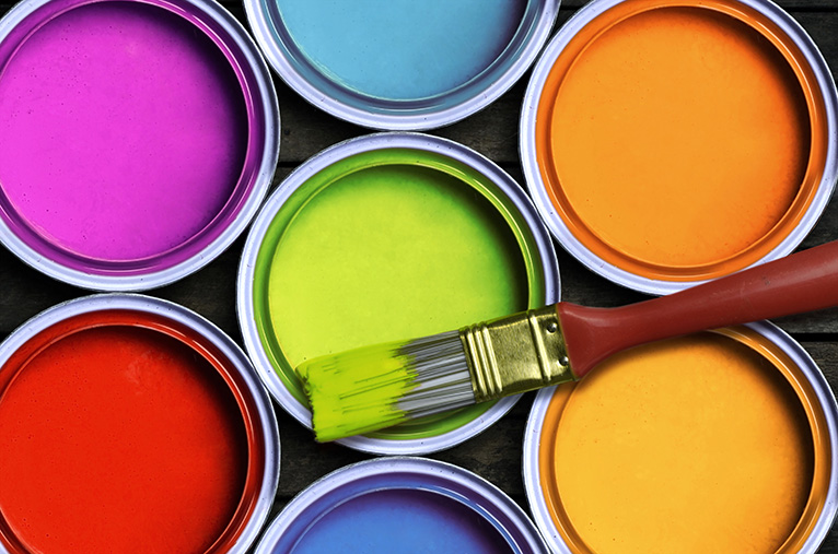 Seven bright pots of paint