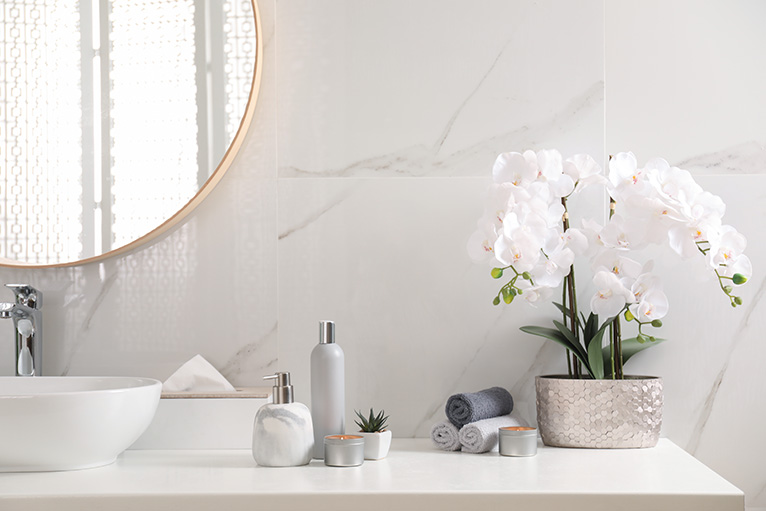 Holiday home advice: Hand towels, toiletries and flowers on bathroom sink