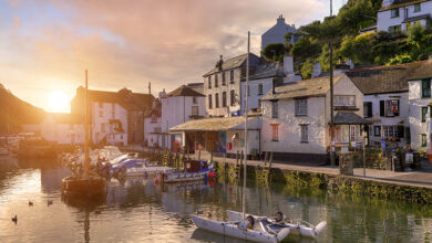 UK holiday homes in the sunrise in a Cornish fishing village