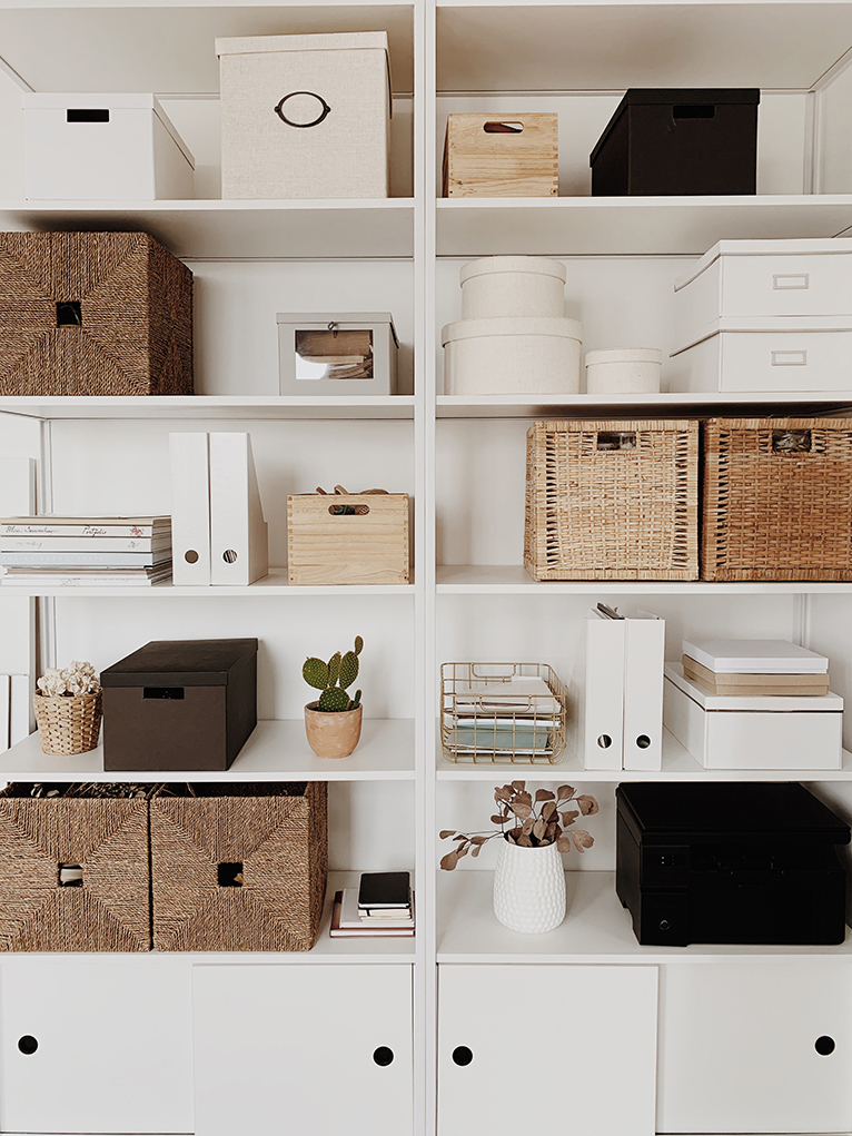 Home office cabinet with rattan boxes, plants and letter trays