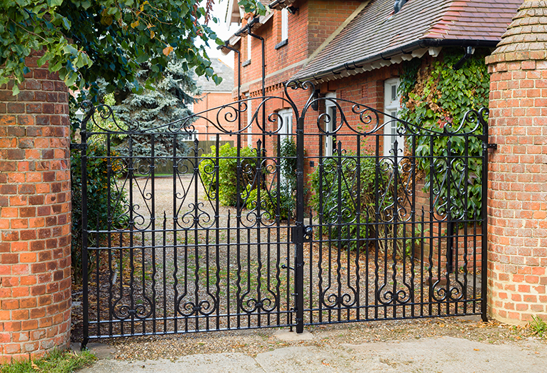 Gated driveway with metal gates