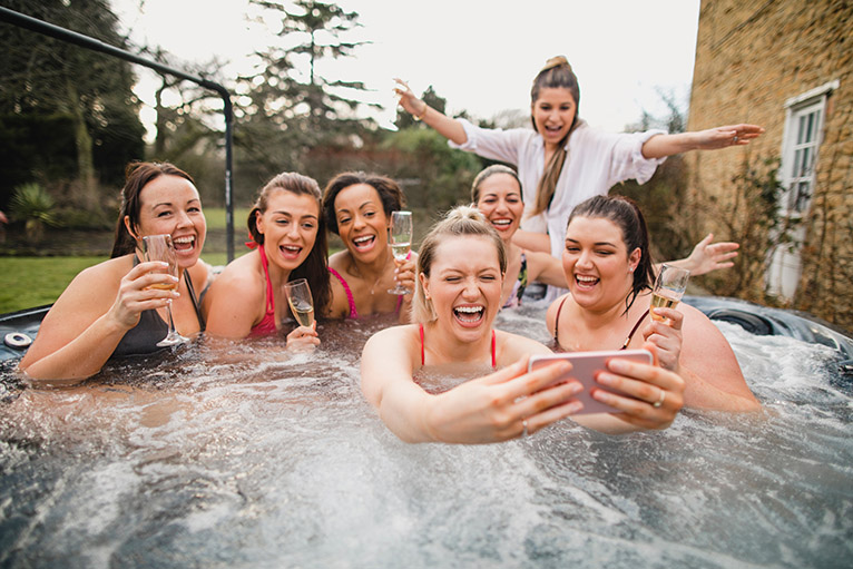 Group of friends in a hot tub on a weekend away