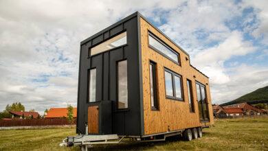 Mobile tiny home near houses