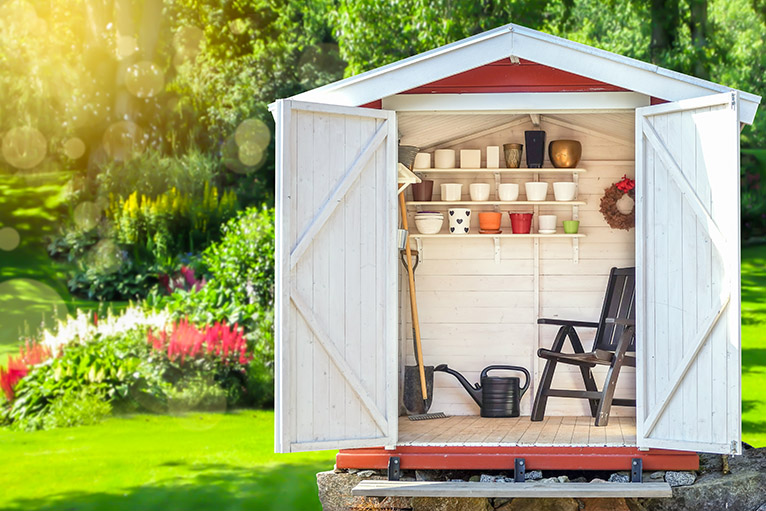 Organised garden shed with chair