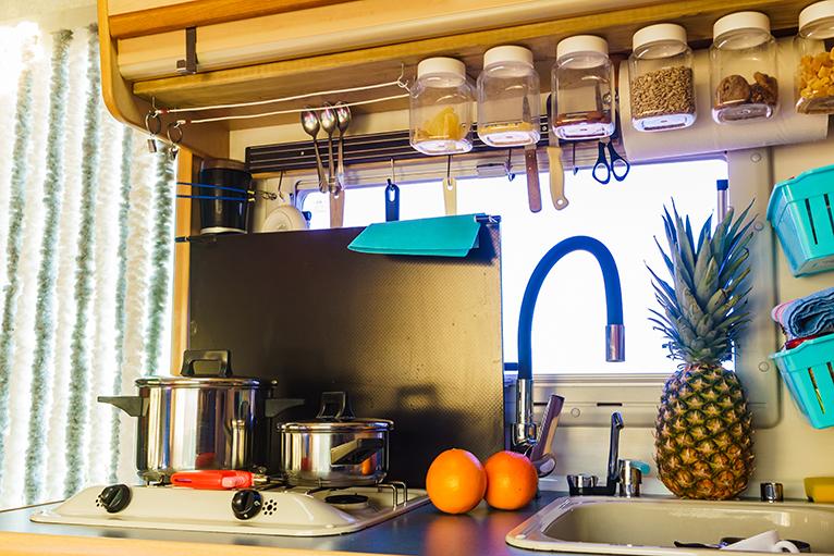 Camper van storage: Hanging jars, magnetic strips and baskets