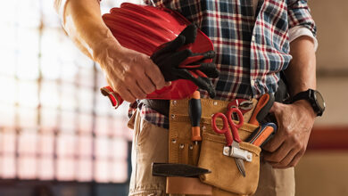 Tradesperson carrying tools in tool belt