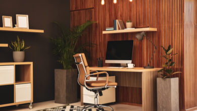 Slimline wall panelling in dark wood on a wall in an orange-themed home office