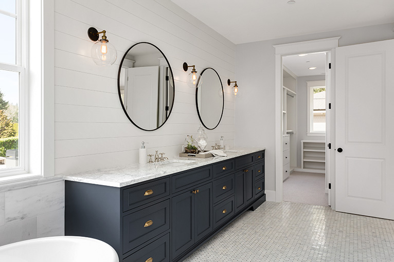 Home lighting: Wall-mounted lights over double bathroom sink