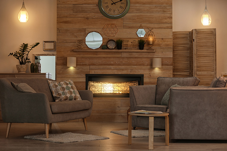 Ceiling mounted lights in cosy and rustic living room