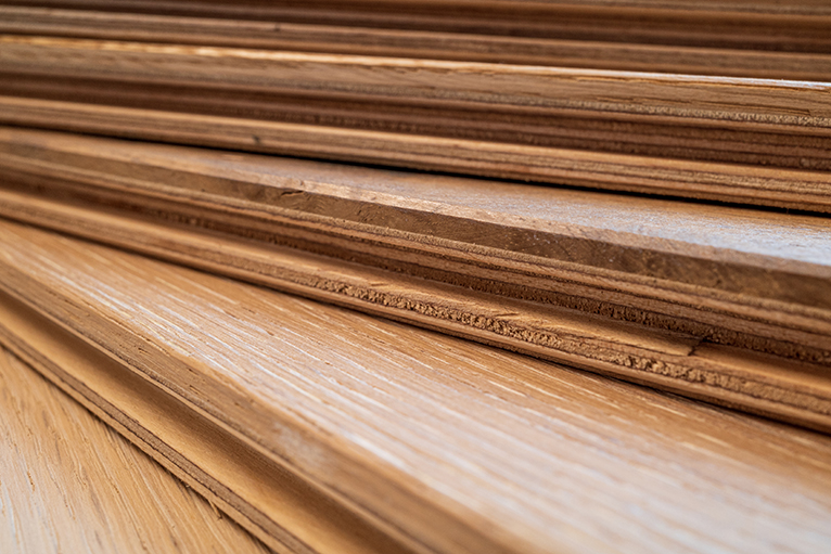 Engineered wooden boards with different layers