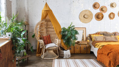 Living room with boho inspired teepee, rattan furniture and plants.
