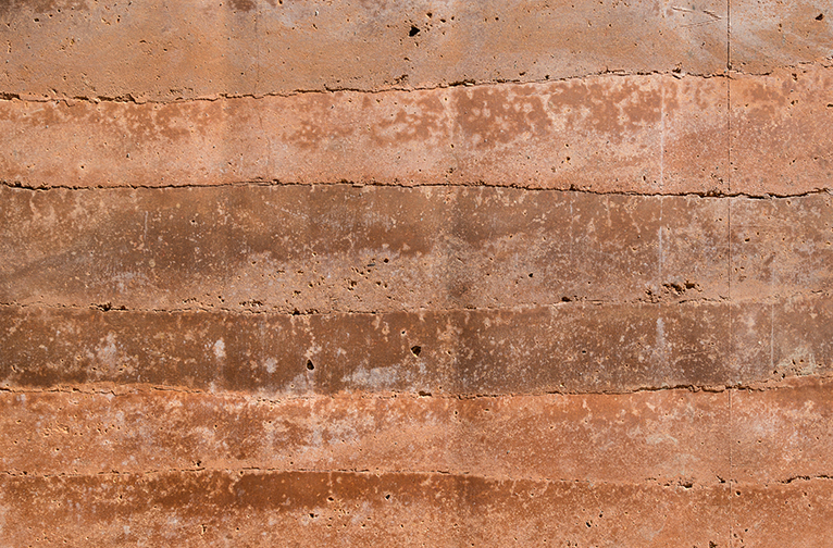 Close up of an eco-friendly, sustainable rammed earth wall.