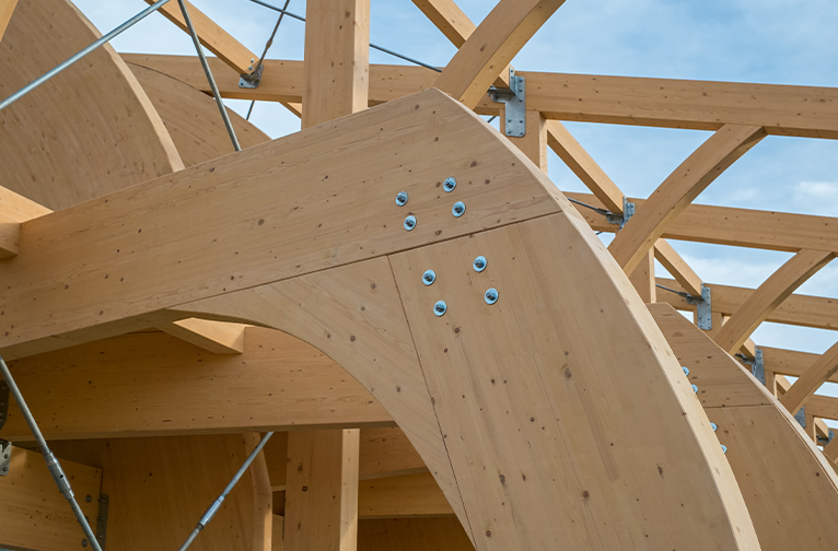 Close up shot house under construction, made up of thick mass timber.